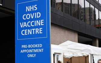epa08971228 People at a Covid-19 vaccination centre at Wembley in London, Britain, 28 January 2021. Britain's national health service (NHS) is coming under severe pressure as Covid-19 hospital admissions are not falling fast enough across the UK. Over one thousand people are dying each day from the disease.  EPA/ANDY RAIN