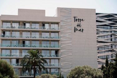 epa09244669 General view of the hotel Torre del Mar after two tourist fell from a room on fourth floor of the building at Platja d'en Bossa beach, in Ibiza island, Spain, 03 June 2021. A Mexican woman, 22, and a Moroccan man, 26, died in the incident that occured early morning. Spanish National Police is conducting further  investigation into the incidence.  EPA/SERGIO G. CANIZARES