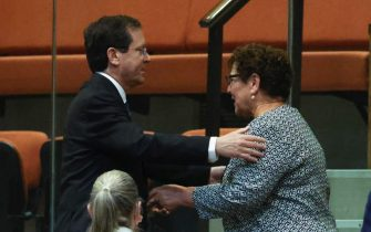 Presidential candidates Isaac Herzog (L) and Miriam Peretz greet each other during a special session of the Knesset whereby Israeli lawmakers elect a new president, at the plenum in the Knesset, Israel's parliament, in Jerusalem, Israel, 02 June 2021.  ANSA/RONEN ZVULUN / POOL