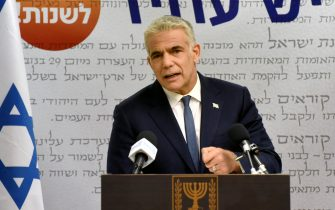 epa09238826 Chairman of the Yesh Atid Party, Yair Lapid, delivers a statement to the press in the Knesset, the Israeli Parliament, in Jerusalem, 31 May 2021. Leader of the Yemina party Bennett on 30 May announced he will form a coalition government with Yair Lapid's Yesh Atid.  EPA/DEBBIE HILL / POOL