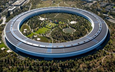 The Apple Park campus stands in this aerial photograph taken above Cupertino, California, U.S., on Wednesday, Oct. 23, 2019. Apple Inc. will report its fourth-quarter results next week, and based on the average analyst price target for the stock, Wall Street is feeling increasingly optimistic about the iPhone maker's prospects. Photographer: Sam Hall/Bloomberg