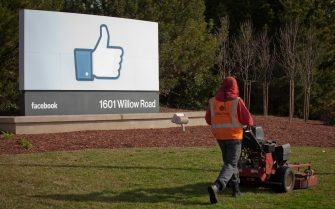 epa08443368 (FILE) - A file photo dated 31 January 2012 showing a grounds keeper mowing the lawn in front of Facebook's new Corporate headquarters in Menlo Park, California, USA (reissued 25 May 2020). German federal court, BGH, is due to announce its long awaited decision 29 May 2020 in data protection lawsuit in a consumer centres vs Facebook case.  EPA/PETER DaSILVA *** Local Caption *** 53295296