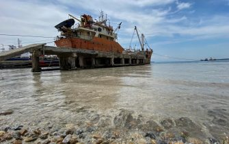 epa09247092 A ship waits at the coast of the Marmara sea covered by sea snot in Istanbul, Turkey, 04 June 2021. Because of global heating, blanket of mucus-like substance in Marmara sea increasing day by day threatens fishing industry and the environment. Sea snot is formed as a result of the proliferation of microalgae called phytoplankton in the sea. The biggest reason for this is that the water temperature in the Marmara sea is 2.5 degrees above the average of the last 40 years.  EPA/ERDEM SAHIN