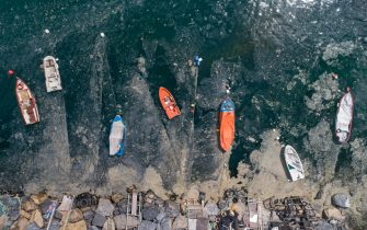 An aerial photo made with a drone shows, fishing boats on the Marmara sea covered by sea snot in Istanbul, Turkey, 30 May 2021. Because of global heating, a blanket of a mucus-like substance in Marmara sea, increasing day by day, threatens fishing industry and the environment. The biggest reason for this is that the water temperature in the Marmara sea is 2.5 degrees above the average of the last 40 years.  ANSA/ERDEM SAHIN  ATTENTION: This Image is part of a PHOTO SET