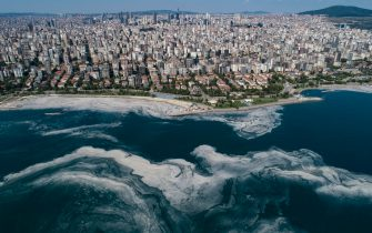 epa09251051 An aerial photo made with a drone shows, the Marmara sea covered by sea snot in Istanbul, Turkey, 06 June 2021. Due to global heating, blanket of mucus-like substance in Marmara sea increasing day by day threatens fishing industry and the environment. According the media reports, sea snot, which is formed as a result of the proliferation of microalgae called phytoplankton in the sea, has descended 30 meters from the surface in some regions on the Marmara sea. The biggest reason for this is that the water temperature in the Marmara sea is 2.5 degrees above the average of the last 40 years.  EPA/ERDEM SAHIN