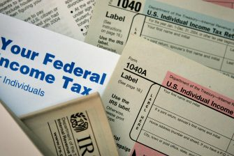CHICAGO - NOVEMBER 1:  Current federal tax forms are distributed at the offices of the Internal Revenue Service November 1, 2005 in Chicago, Illinois. A presidential panel today recommended a complete overhaul of virtually every tax law for individuals and businesses.  (Photo Illustration by Scott Olson/Getty Images)