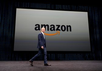 epa08982630 (FILE) - Amazon CEO Jeff Bezos walking on stage at a press conference where he introduced new Kindle products such as the Kindle Paperwhite Wi-Fi + 3G, the Kindle Fire HD and new programs and innovations for the wireless tablets at Santa Monica Airport in Santa Monica, California, USA, 06 September 2012 (Reissued 02 February 2021). Jeff Bezos will step down as CEO of Amazon and will become the executive chair of Amazon s board by the third quarter (Q3). Amazon Web Services (AWS) CEO Andy Jassy will become Amazon's new CEO.  EPA/MICHAEL NELSON *** Local Caption *** 54601700