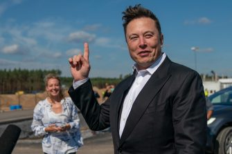 epa08925442 (FILE) - Tesla and SpaceX CEO Elon Musk (R) gives a statement at the construction site of the Tesla Giga Factory in Gruenheide near Berlin, Germany, 03 September 2020 (Reissued 07 January 2021). According to reports on 07 January 2021, Tesla and SpaceX CEO Elon Musk became the world richest person with a net worth of more than 185 billion US dollars, surpassing Jeff Bezos, CEO of Amazon, who is currently worth 184 billion US dollars.  EPA/ALEXANDER BECHER *** Local Caption *** 56315718