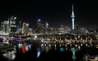 AUCKLAND, NEW ZEALAND - MAY 15: A general nightime view of the Auckland skyline as seen from the new Park Hyatt hotel in the Viaduct Basin area of the city on May 15, 2021 in Auckland, New Zealand. Quarantine-free travel from Australia to New Zealand resumed on Monday 19 April following the closure of international borders in response to the global COVID-19 pandemic. The opening of the trans-Tasman travel bubble is hoped to help New Zealand's tourism industry recover. Prior to COVID-19, Australians made up almost 40% of international arrivals to New Zealand and contributed around 24% or $2.7 billion of New Zealand's annual international visitor spend. (Photo by James D. Morgan/Getty Images)