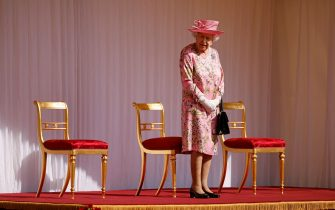 Britain's Queen Elizabeth II waits to greet US President Joe Biden and US First Lady Jill Biden at Windsor Castle in Windsor, west of London, on June 13, 2021. - US president Biden will visit Windsor Castle late Sunday, where he and First Lady Jill Biden will take tea with the queen. (Photo by Tolga Akmen / AFP) (Photo by TOLGA AKMEN/AFP via Getty Images)