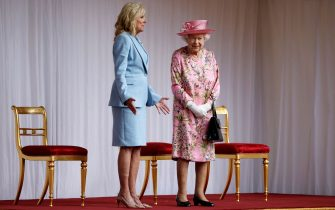 US First Lady Jill Biden (L) speaks with Britain's Queen Elizabeth II at the dais in the Quadrangle of Windsor Castle in Windsor, west of London, on June 13, 2021. - US president Biden will visit Windsor Castle late Sunday, where he and First Lady Jill Biden will take tea with the queen. (Photo by Tolga Akmen / AFP) (Photo by TOLGA AKMEN/AFP via Getty Images)