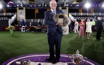 epa09269343 Dog owner, breeder and handler David Fitzpatrick poses with 'Wasabi', a Pekingese breed, winner of Best in Show during the 145th Annual Westminster Kennel Club Dog show on the grounds of the Lyndhurst Estate, a historic mansion, in Tarrytown, New York, USA, 13 June 2021. This year s dog show was delayed from its normal time in February due to the coronavirus pandemic and is being held from 11 to 13 June 2021.  EPA/Peter Foley