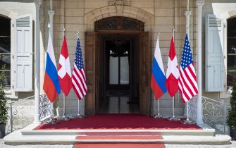 epa09273034 Flags of the US, Russia and Switzerland photographed in front of the entrance of the villa La Grange, one day prior to the US - Russia summit in Geneva, Switzerland, 15 June 2021. The meeting between US President Joe Biden and Russian President Vladimir Putin is scheduled in Geneva for 16 June 2021.  EPA/PETER KLAUNZER