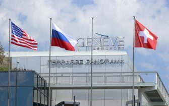 epa09273061 Flags of the US, Russia and Switzerland fly at Cointrin airport ahead of a meeting between US President Joe Biden and his Russian counterpart Vladimir Putin, in Geneva, Switzerland, 15 June 2021. The meeting between US President Joe Biden and Russian President Vladimir Putin is scheduled in Geneva for 16 June 2021.  EPA/DENIS BALIBOUSE / POOL