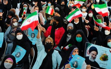 epa09271207 Women supporters of Iranian presidential candidate Ebrahim Raisi hold pictures depicting him, during an election campaign rally in Tehran, Iran, 14 June 2021. Iranians will vote in a presidential election on 18 June 2021.  EPA/ABEDIN TAHERKENAREH
