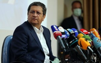 epa09272521 Iranian presidential candidate Abdolnaser Hemati speaks during press conference in Tehran, Iran, 15 June 2021. Iranians will vote in a presidential election on 18 June 2021.  EPA/ABEDIN TAHERKENAREH