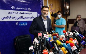 epa09228411 Iranian presidential candidate Amir Hossein Ghazizadeh arrives during a press conference at the Fars News Agency in Tehran, Iran, 26 May 2021. Iranian guardian council approved seven candidates to run for presidential election on 18 June 2021.  EPA/ABEDIN TAHERKENAREH