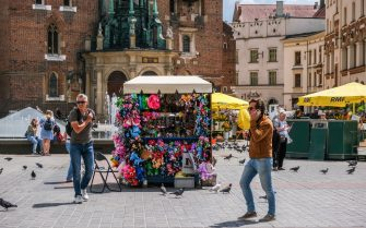 KRAKOW, POLAND - 2021/06/14: View of a local stand selling souvenirs at Krakow's UNESCO listed Main Square.From June 1st, Poland introduced the COVID Digital certificate and travelers fully vaccinated are exempt from quarantine. (Photo by Omar Marques/SOPA Images/LightRocket via Getty Images)