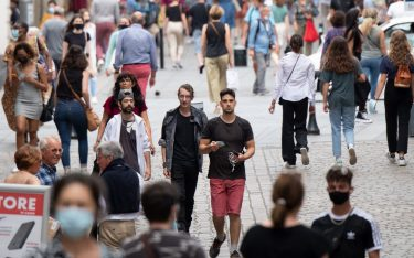 Pedestrians walk down a street in downtown Nantes, on June 17, 2021, as people are allowed in France to remove face masks when outside for the first time since autumn 2020. - The easing of coronavirus rules came as authorities hailed a rapid decline in new cases on the eve of summer holidays. The nationwide curfew of 11 pm will also be lifted ahead of schedule on June 20, 2021. (Photo by LOIC VENANCE / AFP) (Photo by LOIC VENANCE/AFP via Getty Images)