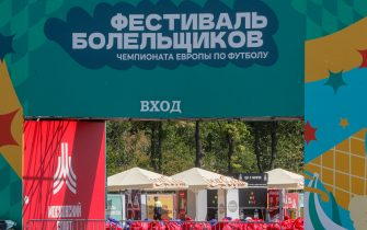 epa09282541 A security man stands in the official fan zone in Moscow, Russia, 18 June 2021. Over the past 24 hours, 9,056 cases of COVID-19 coronavirus infection have been detected in Moscow, which has become a new absolute record since the beginning of the pandemic. Mass entertainment events with more than 1,000 participants are prohibited in Moscow, while dance floors and fan zones for football fans are being closed.  EPA/SERGEI ILNITSKY