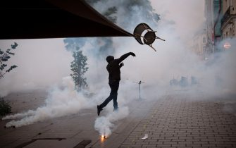 A demonstrator throw a chair against with anti-riot gendarmes during a second protest to mark the second anniversary of the death of Steve Maia Canico, a Frenchman who died after falling in the river following a police raid during France's annual nationwide Fete de la Musique celebrations in 2019, in the city of Nantes on June 21, 2021. - Steve Maia Canico, 24-years-old, went missing on the night of June 21-22, 2019, after officers in the western city of Nantes moved in to disperse techno music fans attending a free concert as part of France's national music celebration day. (Photo by LOIC VENANCE / AFP) (Photo by LOIC VENANCE/AFP via Getty Images)