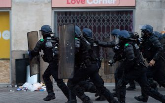 Anti-riot gendarmes run to face demonstrators during a second protest to mark the second anniversary of the death of Steve Maia Canico, a Frenchman who died after falling in the river following a police raid during France's annual nationwide Fete de la Musique celebrations in 2019, in the city of Nantes on June 21, 2021. - Steve Maia Canico, 24-years-old, went missing on the night of June 21-22, 2019, after officers in the western city of Nantes moved in to disperse techno music fans attending a free concert as part of France's national music celebration day. (Photo by LOIC VENANCE / AFP) (Photo by LOIC VENANCE/AFP via Getty Images)