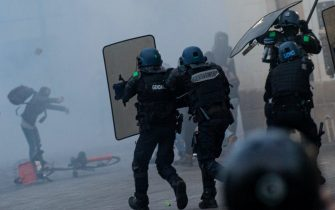 Demonstraters fight with anti-riot gendarmes during a second protest to mark the second anniversary of the death of Steve Maia Canico, a Frenchman who died after falling in the river following a police raid during France's annual nationwide Fete de la Musique celebrations in 2019, in the city of Nantes on June 21, 2021. - Steve Maia Canico, 24-years-old, went missing on the night of June 21-22, 2019, after officers in the western city of Nantes moved in to disperse techno music fans attending a free concert as part of France's national music celebration day. (Photo by LOIC VENANCE / AFP) (Photo by LOIC VENANCE/AFP via Getty Images)