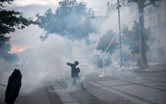 A demonstrator fights with anti-riot gendarmes during a second protest to mark the second anniversary of the death of Steve Maia Canico, a Frenchman who died after falling in the river following a police raid during France's annual nationwide Fete de la Musique celebrations in 2019, in the city of Nantes on June 21, 2021. - Steve Maia Canico, 24-years-old, went missing on the night of June 21-22, 2019, after officers in the western city of Nantes moved in to disperse techno music fans attending a free concert as part of France's national music celebration day. (Photo by LOIC VENANCE / AFP) (Photo by LOIC VENANCE/AFP via Getty Images)