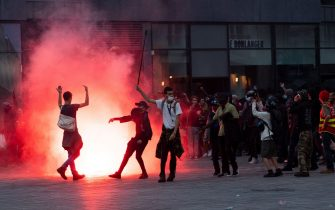 Demonstrators fight with anti-riot gendarmes during a second protest to mark the second anniversary of the death of Steve Maia Canico, a Frenchman who died after falling in the river following a police raid during France's annual nationwide Fete de la Musique celebrations in 2019, in the city of Nantes on June 21, 2021. - Steve Maia Canico, 24-years-old, went missing on the night of June 21-22, 2019, after officers in the western city of Nantes moved in to disperse techno music fans attending a free concert as part of France's national music celebration day. (Photo by LOIC VENANCE / AFP) (Photo by LOIC VENANCE/AFP via Getty Images)