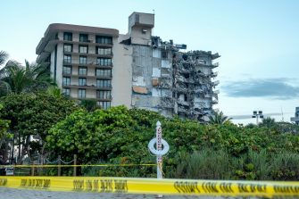 epa09298447 A view of the partial collapsed 12-story condominium building in Surfside, Florida, USA, 24 June 2021. Miami-Dade Fire Rescue officials said more than 80 units responded to the collapse at the condominium building near 88th Street and Collins Avenue just north of Miami Beach around 2 a.m.  EPA/CRISTOBAL HERRERA-ULASHKEVICH