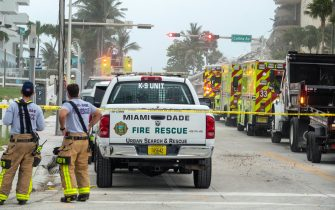 epa09298885 Miami-Dade Rescue team is searching in the partial collapse of a 12-story condominium building in Surfside, Florida, USA, 24 June 2021. Miami-Dade Fire Rescue officials said more than 80 units responded to the collapse at the condominium building near 88th Street and Collins Avenue just north of Miami Beach around 2 a.m. Surfside Mayor Charles W. Burkett  said during a press conference that one person has died, and at least 10 others were injured in the accident.  EPA/CRISTOBAL HERRERA-ULASHKEVICH