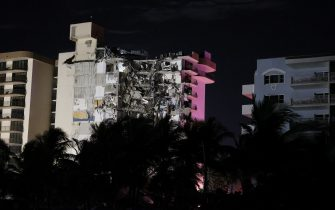 SURFSIDE, FLORIDA - JUNE 24:  Rescue personnel work near where a portion of the 12-story condo tower crumbled to the ground during a partial collapse of the building on June 24, 2021 in Surfside, Florida. It is unknown at this time how many people were injured as search-and-rescue effort continues with rescue crews from across Miami-Dade and Broward counties. (Photo by Joe Raedle/Getty Images)