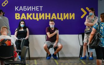 epa09300790 A Russian man sits at a vaccination point after receiving an injection of Russia's Sputnik V (Gam-COVID-Vac) vaccine against COVID-19 at the vaccination point at the shopping center Solaris in Moscow, Russia, 25 June 2021. According to the Mayor of Moscow Sergey Sobyanin, starting 28 June 2021, only those who have been vaccinated against COVID-19 and who have recovered within the last six months, or with a negative PCR test valid for three days, will be able to visit catering places in Moscow.  EPA/YURI KOCHETKOV