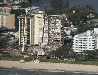 epa09305345 An aerial view of the partial collapsed 12-story condominium building in Surfside, Florida, USA, 27 June 2021. The 12-story beachfront condominium building in the Miami suburb of Surfside, partially collapsed early 24 June 2021.  EPA/CRISTOBAL HERRERA-ULASHKEVICH