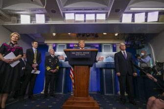U.S. President Donald Trump, center, speaks during a news conference at the White House in Washington D.C., U.S. on Monday, April 20, 2020. Negotiations between Democrats and the Trump administration on a deal to replenish a small business aid program and assist hospitals spilled into Monday as both sides raced to put together a package that Congress could approve this week. Photographer: Tasos Katopodis/Bloomberg via Getty Images