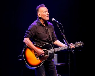 """NEW YORK, NEW YORK - JUNE 26: Bruce Springsteen performs during reopening night of """"Springsteen on Broadway"""" for a full-capacity, vaccinated audience at St. James Theatre on June 26, 2021 in New York City. This is the first full capacity Broadway performance since the COVID-19 pandemic shuttered Broadway in March of 2020. (Photo by Taylor Hill/Getty Images)"""