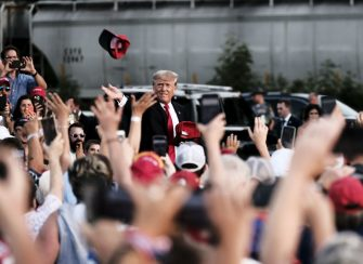 Former US President Donald Trump tosses out MAGA hats and greets his supporters during a 'Save America' Rally at the Lorain County Fairgrounds in Wellington, Ohio, U.S., on Saturday, June 26, 2021. The rally marks Trump's first rally in Ohio since he won the state in the 2020 presidential election, but Ohio's top two Republicans -- Governor Mike DeWine and Lt. Governor John Husted will not attend, according to The Columbus Dispatch. Photographer: Matthew Hatcher/Bloomberg via Getty Images