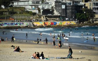 epa09304972 People on the sand at Bondi Beach in Sydney, Australia, 27 June 2021. More than five million people in Greater Sydney and its surrounds have gone into a 14-day lockdown as health authorities try to regain control of a coronavirus disease outbreak.  EPA/JOEL CARRETT AUSTRALIA AND NEW ZEALAND OUT