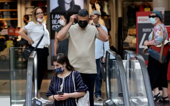 Israelis wear protectives against Covid-19 at a shopping mall in Jerusalem on June 25, 2021. - The Israeli health ministry reimposed a requirement for masks to be worn in enclosed public places following a surge in Covid cases since it was dropped 10 days ago. (Photo by Emmanuel DUNAND / AFP) (Photo by EMMANUEL DUNAND/AFP via Getty Images)