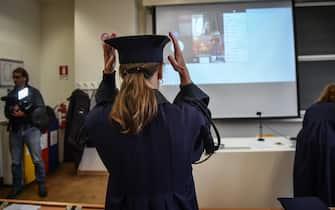 La commissione di laurea nell aula vuota con il laureando in collegamento web - Le sessioni di laurea al Politecnico di Milano online a causa dell emergenza del coronavirus Covid-19, Milano  5 Marzo 2020. Ansa/Matteo Corner