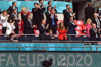 epa09311561 Britain's Prince William (C-L), his wife Catherine (C-R), Duchess of Cambridge, and their son Prince George (C) celebrate England's 1-0 lead during the UEFA EURO 2020 round of 16 soccer match between England and Germany in London, Britain, 29 June 2021.  EPA/Justin Tallis / POOL (RESTRICTIONS: For editorial news reporting purposes only. Images must appear as still images and must not emulate match action video footage. Photographs published in online publications shall have an interval of at least 20 seconds between the posting.)