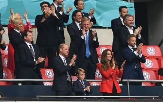 (C-L to C-R) Prince William, Duke of Cambridge, Prince George of Cambridge, and Catherine, Duchess of Cambridge, celebrate the win in the UEFA EURO 2020 round of 16 football match between England and Germany at Wembley Stadium in London on June 29, 2021. (Photo by JUSTIN TALLIS / POOL / AFP) (Photo by JUSTIN TALLIS/POOL/AFP via Getty Images)