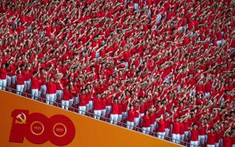BEIJING, CHINA - JUNE 28: Members of the audience wave during a mass gala marking the 100th anniversary of the Communist Party on June 28, 2021 at the Olympic Bird's Nest stadium in Beijing, China. China will officially mark the 100th anniversary of the founding of the Communist Party on July 1st. (Photo by Kevin Frayer/Getty Images)