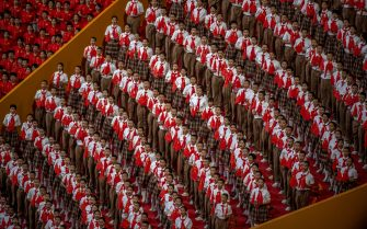 BEIJING, CHINA - JUNE 28: School children and members of the audience stand with flags during the playing of the anthem at a mass gala marking the 100th anniversary of the Communist Party on June 28, 2021 at the Olympic Bird's Nest stadium in Beijing, China. China will officially mark the100th anniversary of the founding of the Communist Party on July 1st. (Photo by Kevin Frayer/Getty Images)