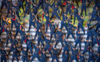 BEIJING, CHINA - JUNE 28: Performers dance in revolutionary costume during a mass gala marking the 100th anniversary of the Communist Party on June 28, 2021 at the Olympic Bird's Nest stadium in Beijing, China. China will officially mark the 100th anniversary of the founding of the Communist Party on July 1st. (Photo by Kevin Frayer/Getty Images)