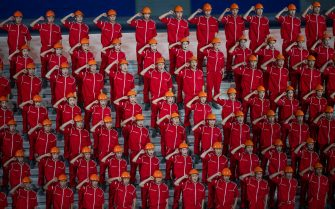 BEIJING, CHINA - JUNE 28: Performers dressed as workers perform during a mass gala marking the 100th anniversary of the Communist Party on June 28, 2021 at the Olympic Bird's Nest stadium in Beijing, China. China will officially mark the 100th anniversary of the founding of the Communist Party on July 1st. (Photo by Kevin Frayer/Getty Images)