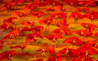 BEIJING, CHINA - JUNE 28: Performers dance with red flags during a mass gala marking the 100th anniversary of the Communist Party on June 28, 2021 at the Olympic Bird's Nest stadium in Beijing, China. China will officially mark the100th anniversary of the founding of the Communist Party on July 1st. (Photo by Kevin Frayer/Getty Images)