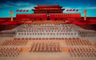 BEIJING, CHINA - JUNE 28: Performers dance in front of a screen showing the Tiananmen Gate and the portrait of the late Chairman Mao Zedong during a mass gala marking the 100th anniversary of the Communist Party on June 28, 2021 at the Olympic Bird's Nest stadium in Beijing, China. China will officially mark the100th anniversary of the founding of the Communist Party on July 1st. (Photo by Kevin Frayer/Getty Images)