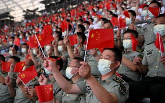 Audience wave national flags as they watch a Cultural Performance as part of the celebration of the 100th Anniversary of the Founding of the Communist Party of China, at the Bird's nest national stadium in Beijing on June 28, 2021. - The 100th anniversary is scheduled for July 1. (Photo by Noel CELIS / AFP) / The erroneous mention[s] appearing in the metadata of this photo by NOEL CELIS has been modified in AFP systems in the following manner: BYLINE [NOEL CELIS] instead of [GREG BAKER]. Please immediately remove the erroneous mention[s] from all your online services and delete it (them) from your servers. If you have been authorized by AFP to distribute it (them) to third parties, please ensure that the same actions are carried out by them. Failure to promptly comply with these instructions will entail liability on your part for any continued or post notification usage. Therefore we thank you very much for all your attention and prompt action. We are sorry for the inconvenience this notification may cause and remain at your disposal for any further information you may require. (Photo by NOEL CELIS/AFP via Getty Images)