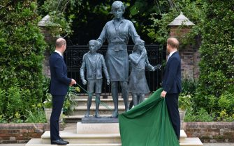 The Duke of Cambridge (left) and Duke of Sussex look at a statue they commissioned of their mother Diana, Princess of Wales, in the Sunken Garden at Kensington Palace, London, on what would have been her 60th birthday. Picture date: Thursday July 1, 2021.